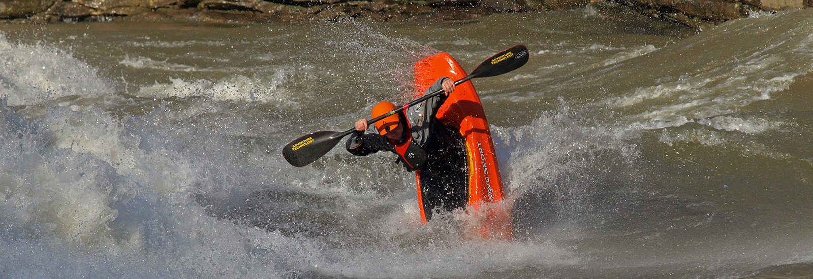 kayaker using project x in rapids