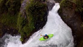 Woman kayaking in a rushing river