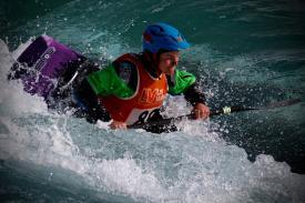 Woman kayaking in blue water