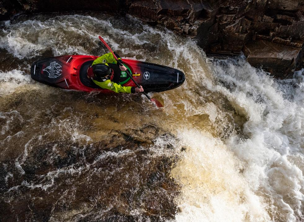 kayaker on rapids