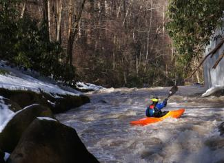 kayaker on a cold river